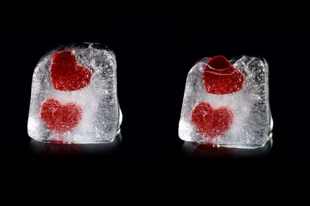 Four hearts in melting icecubes with small reflection on black background photo