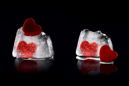 Four hearts in melting icecubes with medium reflection on black background photo