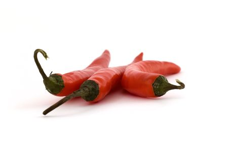Three chili peppers in close up at isolated white background photo