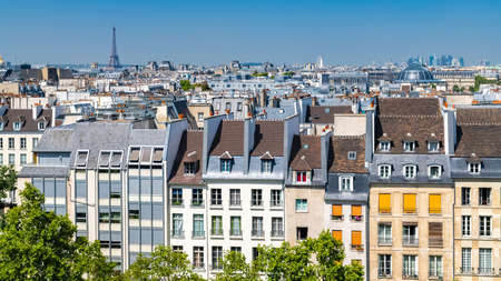 Paris, typical buildings and roofs in the Marais, aerial view from the Pompidou Center, with the Eiffel Tower in background