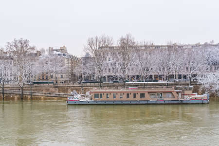 Paris under the snow and floods, flooded quays, trees under the water, the Seine in winter Stock fotó