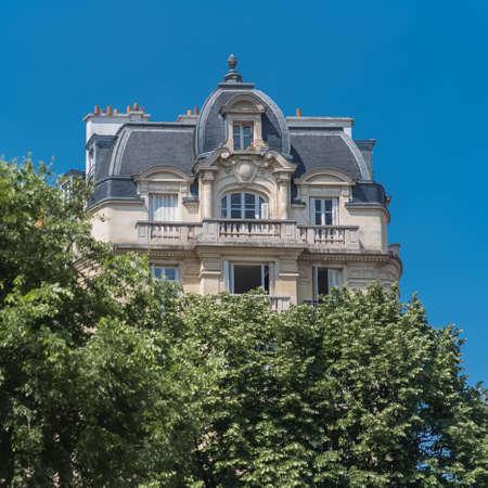 Paris, beautiful building, typical parisian facade in the Marais