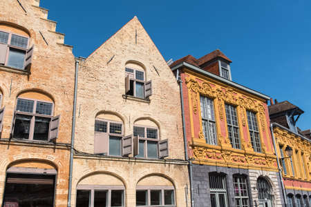 Lille, ancient houses in the center, and the belfry of the Chambre de Commerce Stock Photo