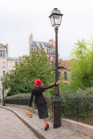 Montmartre, beautiful girl with retro clothes walking in Montmartre Stock Photo