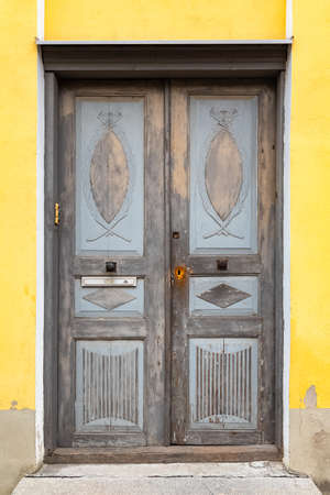 Tallinn in Estonia, wooden colorful door in the medieval city center, typical house
