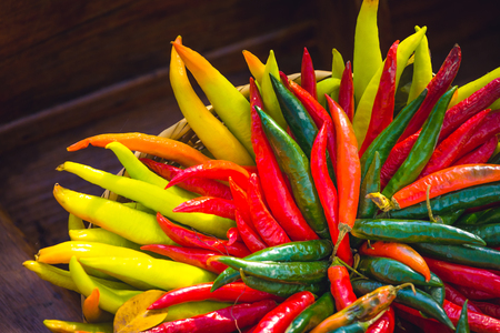 red , yellow and green chilli peppers in floating market in thailand