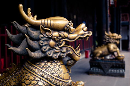 Close up of lion bronze head statue in a temple of China