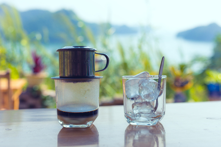 traditional Vietnamese coffee with landscape in background