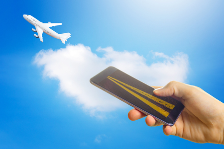 Buying airline tickets online concept. Smartphone or mobile phone with runway . the airplane takes off .