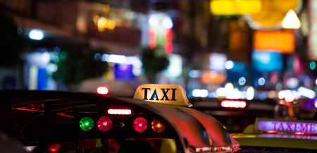 Tuk-Tuk Taxi sign with defocused lights blur in Chinatown in Bangkok at night , Thailand , Southeast asia . Stock Photo