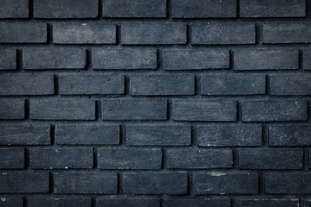 Old black brick wall texture background