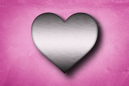metal heart shape on pink concrete wall background . 3D rendering , love concept .