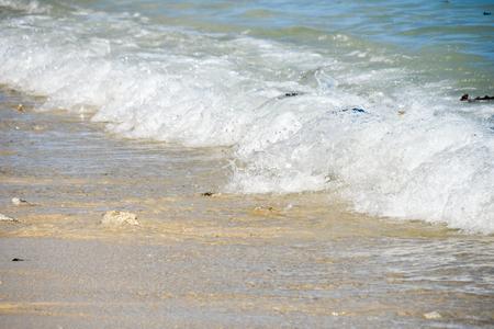 Sea wave on sandy beach, Mauritius