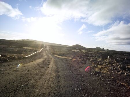Dirt road in volcanic dramatic area in Iceland with pipeline. Backplate for offroad 4x4 4WD cars. 免版税图像