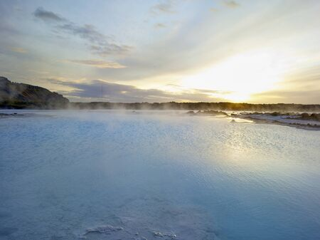 Beautiful landscape sunset Blue Lagoon thermal bath in Iceland with steam in a cold atmosphere reflections in colourful water Stok Fotoğraf