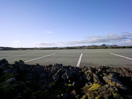 Big parking area with lots of parking spaces in Iceland in a volcanic landscape with rocks and moss. Backplate for automobile industry and cgi. Stok Fotoğraf - 137897641