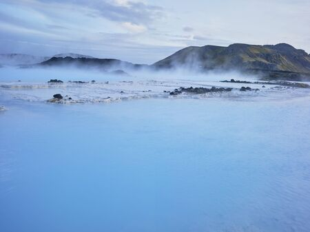 Beautiful landscape of Blue Lagoon thermal bath in Iceland with steam in a cold atmosphere in dusk colourful water Stok Fotoğraf
