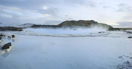 Beautiful panorama landscape of Blue Lagoon thermal bath in Iceland with steam in dusk colourful water