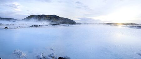 Beautiful panorama landscape of Blue Lagoon thermal bath in Iceland with steam in sunset colourful water Stok Fotoğraf