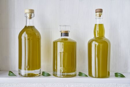 detail olive oil bottle bottles oils three living gold food cooking natural organic beauty  country house healthy stylish white leef green kitchen shelf closeup