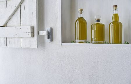bottle bottles kitchen shelf ambiance olive oil bottle oils four copy space food cooking natural organic beauty home country house healthy stylish white gold barn copy space Stok Fotoğraf - 138033908