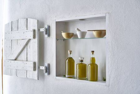 hous home design wall shelf  Olive oil bottle oils three bottles shelf food cooking mediterranean natural organic toscany beauty country house healthy stylish white copy space kitchen barn italy spain greece
