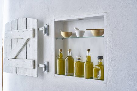 greek olive oil hous home design wall shelf   bottle oils three bottles shelf food cooking mediterranean natural organic toscany beauty country house healthy stylish white copy space kitchen barn italy spain greece