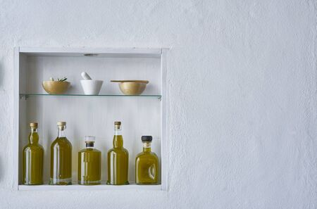 fresh harvest new spanish olive oil hous home design wall shelf   bottle oils three bottles shelf food cooking mediterranean natural organic toscany beauty country house healthy stylish white copy space kitchen barn italy spain greece Stok Fotoğraf