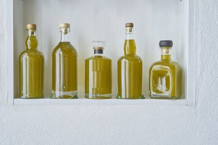 winner best olive oil bottles fresh harvest new greek closeup wall shelf bottle oils shelf food organic cooking mediterranean natural organic toscany healthy stylish white copy space kitchen italy spain greece Stok Fotoğraf - 138034023