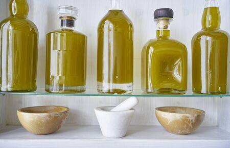mortar bottlles bowl detail in kitchen shelf closeup Reklamní fotografie
