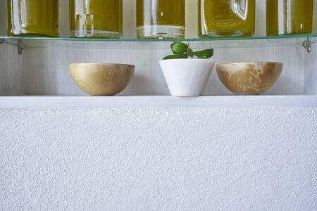 copy space kitchen shelf detail olive oil bottle kitchen closeup glass bowl deco bottles oils gold food cooking natural organic bowl Stok Fotoğraf - 138033737