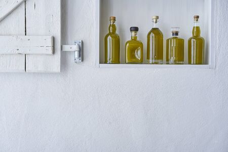 Olive oil bottle oils five bottles shelf food cooking mediterranean natural organic toscany beauty home country house healthy stylish white copy space kitchen Stok Fotoğraf - 138033655