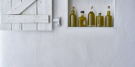 panoramic Olive oil bottle oils five bottles shelf food cooking mediterranean natural organic toscany beauty home country house healthy stylish white copy space kitchen