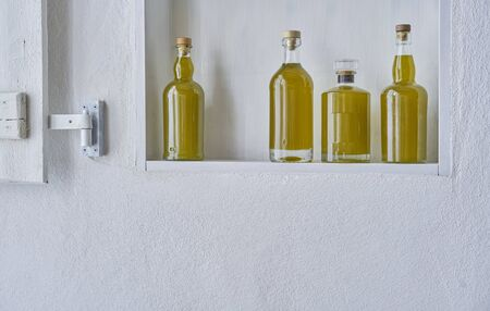 bottle bottles kitchen shelf olive oil bottle oils four copy space food cooking natural organic beauty home country house healthy stylish white