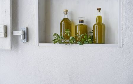 kitchen shelf olive oil bottle bottles oils three branch detail living copy space food cooking natural organic beauty  country house healthy stylish white leef green