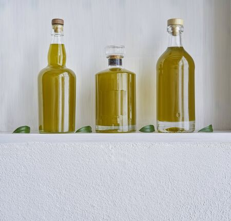 kitchen shelf olive oil bottle bottles oils three  detail living copy space food cooking natural organic beauty  country house healthy stylish white leef green