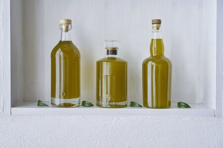 olive oil bottle bottles oils three  detail living copy space food cooking natural organic beauty  country house healthy stylish white leef green kitchen shelf Stok Fotoğraf