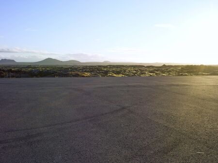 parking area in iceland green moss  landscape in background, backplate for cgi automobil industry