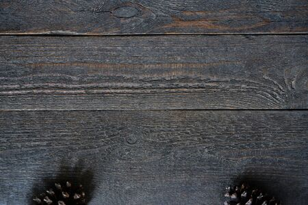Weathered wooden boards with fir cones as a background with copy space Stok Fotoğraf