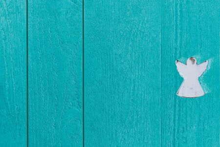 Colourful blue-green boards of wood with an angel, backdrop and copy space Stok Fotoğraf