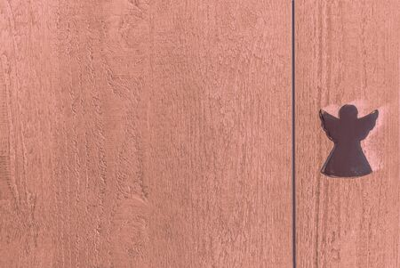 Bright red wooden textured planks with an angel, background and copy space Stok Fotoğraf