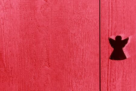 Colourful red textured wooden background with an angel, copy space Stok Fotoğraf