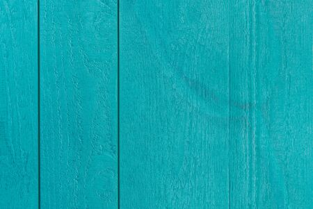 Colourful postcard of bluegreen textured wooden boards with a transparent artful tulip