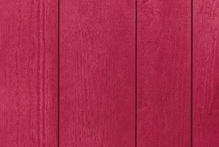 Colourful backdrop of red textured wooden planks