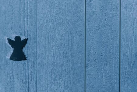 Colourful blue textured wooden background with an angel, copy space