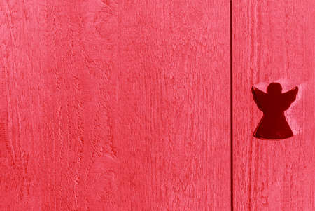 Red wooden textured boards with an angel, background and copy space Stok Fotoğraf