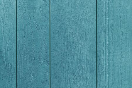 Backdrop of blue-green textured wooden planks