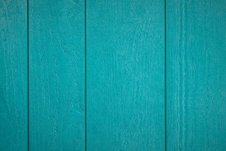 Background of blue-green textured wooden planks