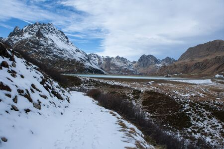 Mountain path with snow with a view of the Silvretta dam in Austria