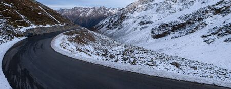 panorama of a winding road with snowy landscape in the ötztal in austria Stok Fotoğraf